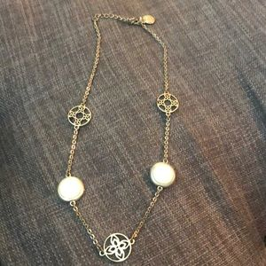 Gold necklace with 2 cream circles